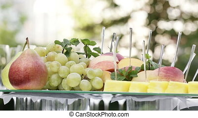 Sliced fruit - Festively decorated buffet table with fruit...