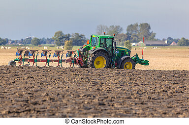 Tractor with Plough in the Field - Farming in the...
