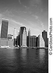 New York City - Lower Manhattan skyline along the East River...