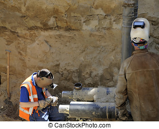 Works on construction of gas pipe - Two men with helmets...