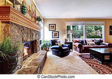 Luxury family room with cozy stone trimmed fireplace. Rich...