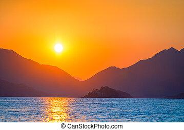 very beautiful sun rises over the sea