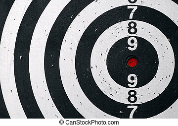 Target - Black and white target sheet with red target.