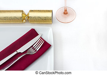 Christmas place setting with gold cracker