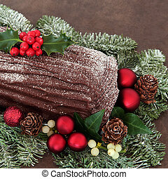Yule Log - Chocolate yule log with red bauble decorations,...