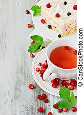 sweet tea party - strawberry tea and a piece of cake with...
