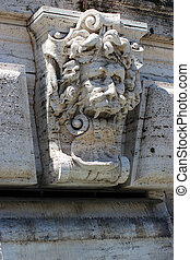detail of marble fountain with a lion, Rome, Italy