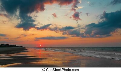 Rising Sun Over Beach Loop - The rising sun is reflected on...