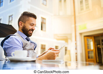 Hipster businessman in cafe - Modern hipster businessman...
