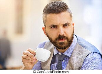 Hipster businessman in cafe - Modern hipster businessman...