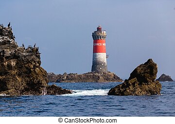 "Lightouse in full sea - The ""Pierres Noires"" lighthouse in..."