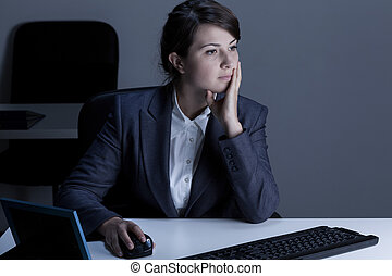 Woman working overtime in the office