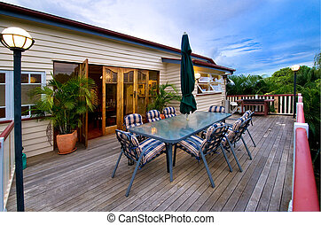 Deck for entertaining - Deck extending out from house with...
