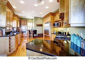 Kitchen with black shiny counter top