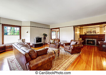 Family room and sitting area with fireplace in old luxury house