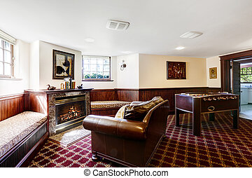 Luxury family room with firepalce and rich leather love seat