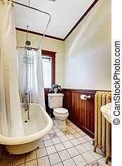 Bathroom with bath tub white wraparound curtain