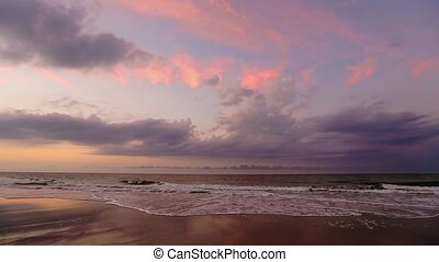 Pastel Surf Loop - Ocean waves break under a sunrise sky...
