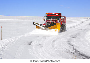 Snowplow Truck - A snowplow truck removing snow from a...