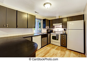 Kitchen room in contrast white and black colors Black...