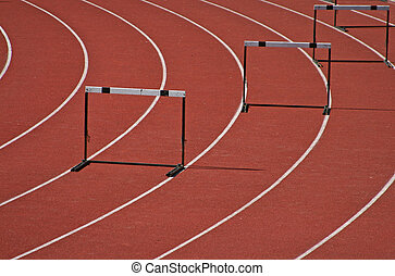 Hurdles in an athletic field