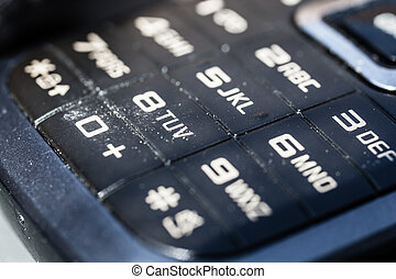Dirty keypad - macro shot of an obsolete and dirty mobile...