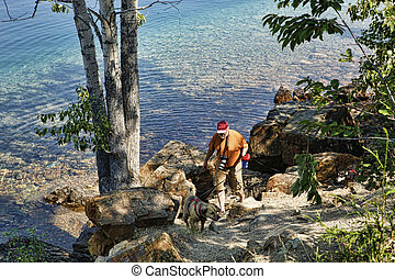 Man Hiking With Dogs - Active senior photographer walking...