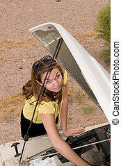 Girl repairing vehicle
