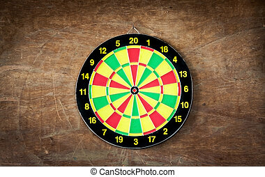 Darts board on wood background