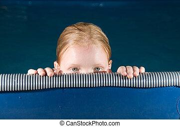 Peek a boo  - Girl peeking over the edge