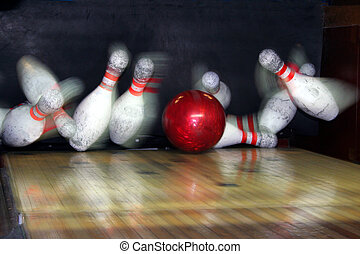 Bowling Strike - A perfect bowling strike, pins caught by...