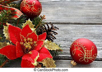 Christmas red balls with bows on the boards, close up