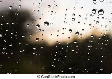 Stormy Raindrops - Raindrops on a window, with a stormy...