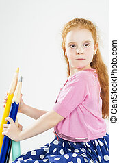 Cute Red-haired Caucasain Girl Holding Huge Pencils. Posing...