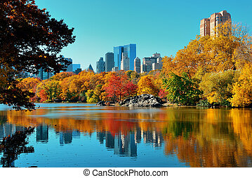 Central Park Autumn and buildings reflection in midtown...