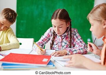 Schoolmates at lesson