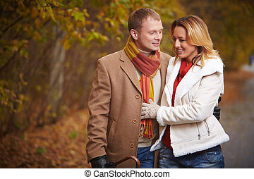 Lovers in park - Portrait of affectionate couple chatting...