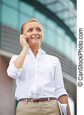 Talking on the phone - Successful businesswoman in...