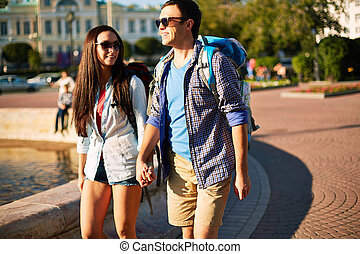 Walking together - Amorous dates with backpacks taking walk...