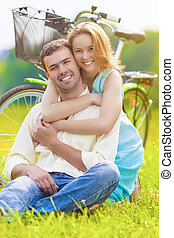 Nice Portrait of Happy Loving Caucasian Couple Sitting Together