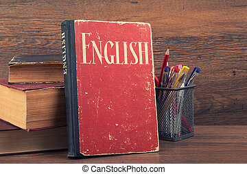 learning english concept book on a wooden background