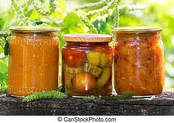 Three jars of canned vegetables outdoors