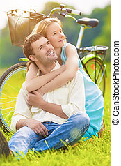 Portrait of Loving Caucasian Couple Sitting Together Outdoors Wi