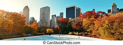 Central Park Autumn ice rink midtown skyline in Manhattan...