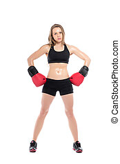 Young sporty woman posing with boxing gloves. Isolated on...