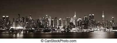 Midtown Manhattan skyline in black and white at dusk...