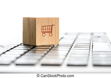 Online shopping and e-commerce concept with a wooden block...