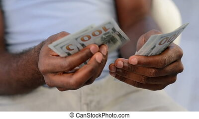 hands counting new hundred bills - Close-up of a...