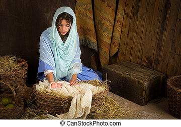 Nativity scene in manger - Teenager girl playing the role of...