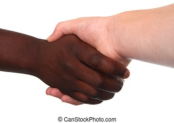 Handshake Multi Racial - Black and white hands shaking in...